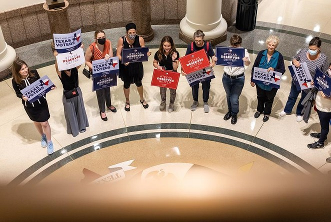 Activists gather outside a Senate committee hearing on proposed election reforms at the Capitol on Saturday, July 10, 2021. - TEXAS TRIBUNE / JORDAN VONDERHAAR
