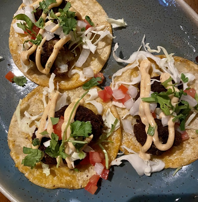 Cuishe offers a variety of street tacos, including a trompo with puerco al pastor. - RON BECHTOL