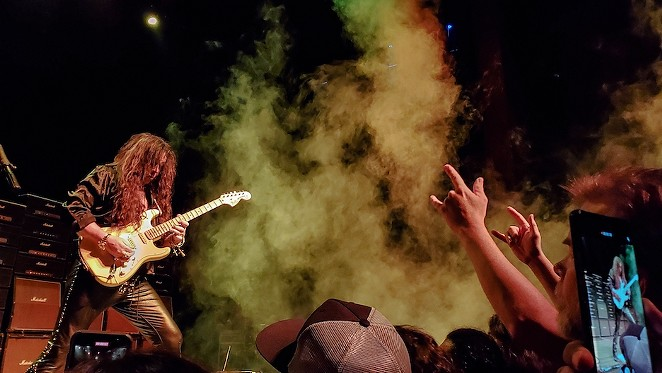 At one point, Malmsteen encouraged fans to meet him at the front of the stage. - OSCAR MORENO