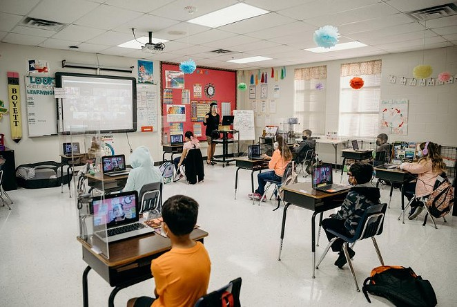 Plexiglass and 6 feet of space between each desk keep students socially distanced in Abigail Boyett's third grade classroom. - TEXAS TRIBUNE / ALEJANDRA CASAS