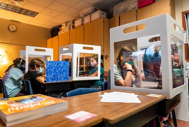 Fifth graders at Jacob's Well Elementary School in Wimberley work from behind desktop barriers meant to prevent the spread of Covid-19 on September 4, 2020. - TEXAS TRIBUNE / JORDAN VONDERHAAR