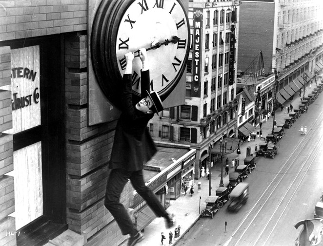 Harold Lloyd hangs from a clock on the side of a skyscraper in the most famous scene from Safety Last! - THE HAROLD LLOYD TRUST