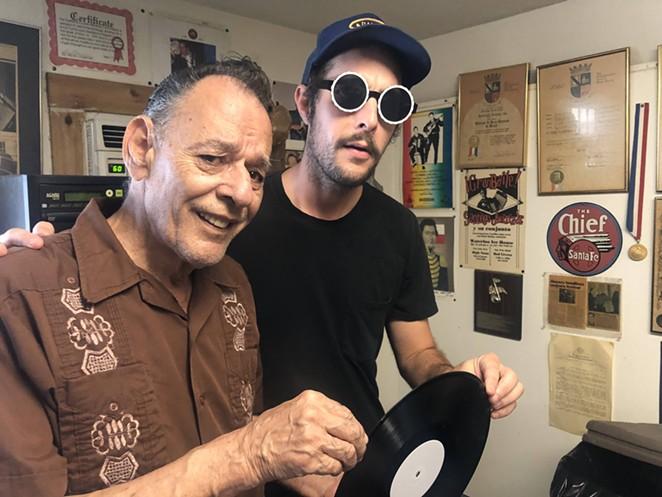 Garrett T. Capps (right) and Santiago Jimenez Jr. get ready to listen to a test pressing of the conjunto legend's latest album. - BILL BAIRD