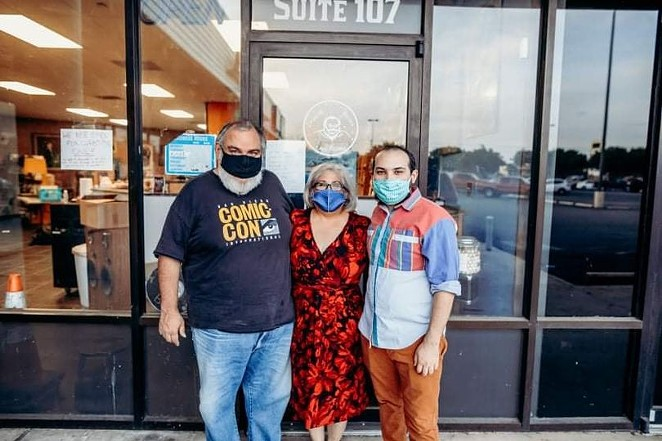 Ezra Hurd (right) and his family stand outside Imagine Books and Records, a retail spot that also doubled as a DIY concert venue for 10 years. - FACEBOOK / IMAGINE BOOKS AND RECORDS