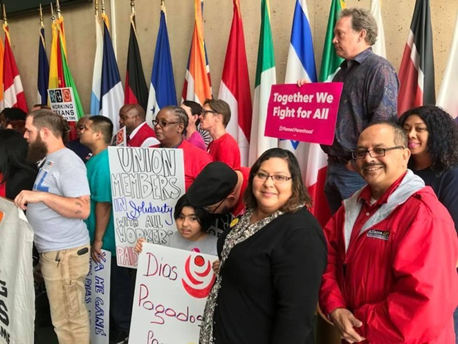 Workers at AFL-CIO Texas rally show their support for mandated paid sick leave. Organizers swayed San Antonio, Austin and Dallas to adopt such policies, but they were overturned in the courts. - PHOTO COURTESY OF AFL-CIO WEBSITE