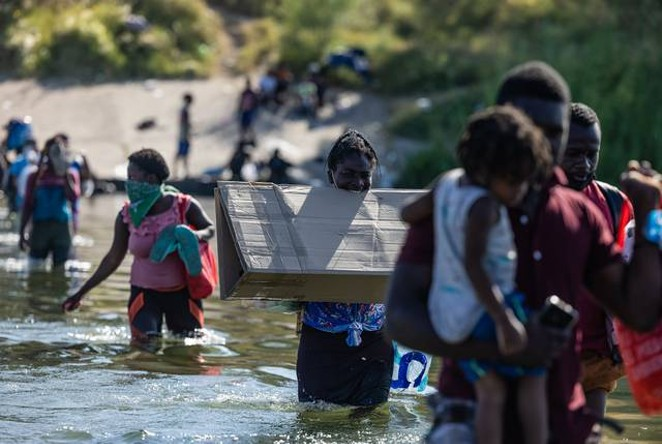 Migrants have waded across the Rio Grande to buy water, food and other supplies in Ciudad Acuña as they wait for their turn to request asylum on the U.S. side. - TEXAS TRIBUNE / JORDAN VONDERHAAR