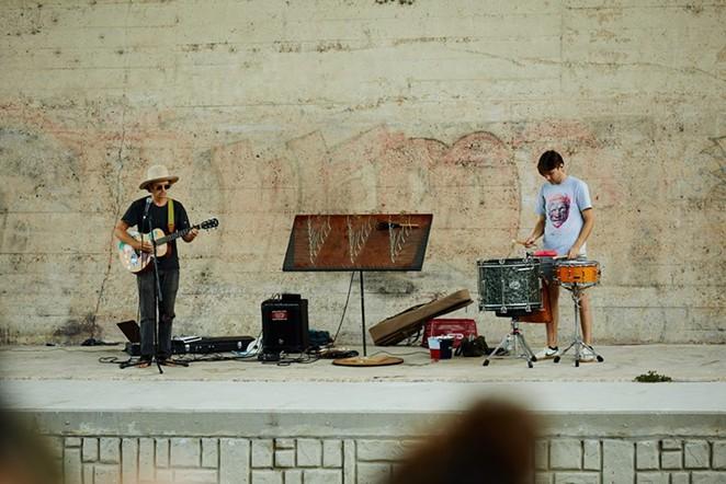 Bill Baird (left) and Jordan Johns perform August 28 under the Roosevelt Avenue Bridge. - SA HERON / TYLER SMITH