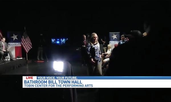 Local trans activist Lauryn Farris lead a walkout during WOAI's town hall on SB 6