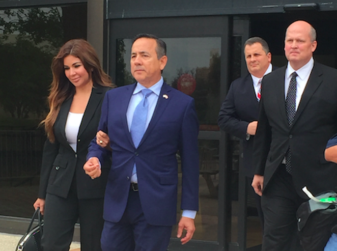Sen. Carlos Uresti leaves San Antonio's federal courthouse after being indicted on fraud and bribery charges. - ALEX ZIELINSKI