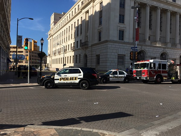 Police swarmed around the federal building downtown Wednesday afternoon - MICHAEL BARAJAS