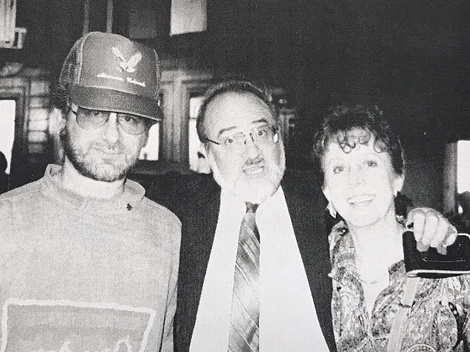 Polunsky (center) and his wife Paulina at a Christmas Party with filmmaker Steven Spielberg. - FLICKER FOOTNOTES