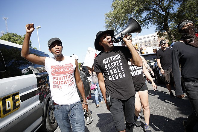 """Jonathan-David Jones and Mike Lowe lead the counter-protest to a """"Save the Monument"""" rally on August 12. - TOMAS GONZALEZ"""