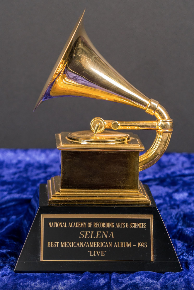 """""""Selena won the Grammy for Best Mexican/American Album of 1993 for her album """"Live!"""" at the 36th annual Grammy Awards on March 1, 1994. The album was recorded during a free concert at the Memorial Coliseum in Corpus Christi, Texas, on February 7, 1993. The award marked many firsts: not only was it her first Grammy, but she was also the first female Tejano artist to receive the award. To this day, Selena is the youngest artist to receive the award in this category."""""""