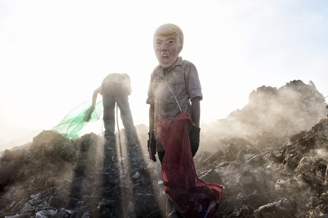 """a young potential trump collecting cans in a landfill"" - PHOTO BY: VERONICA CARDENAS"