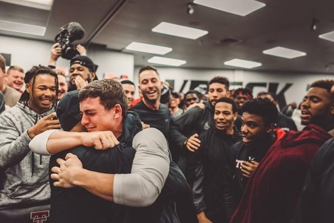 Justus Parker celebrating the good news with his teammates. - @DERRICKSPENCER_/TWITTER