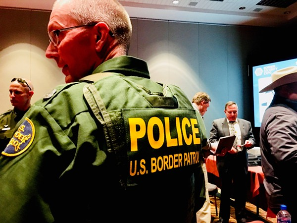 One of many Border Patrol agents in uniform at the Expo. - DEBBIE NATHAN
