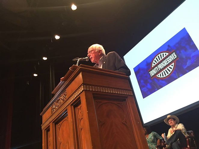 Former presidential candidate and Vermont Sen. Bernie Sanders addresses a crowd at Trinity's Laurie Auditorium Friday night. - SANFORD NOWLIN