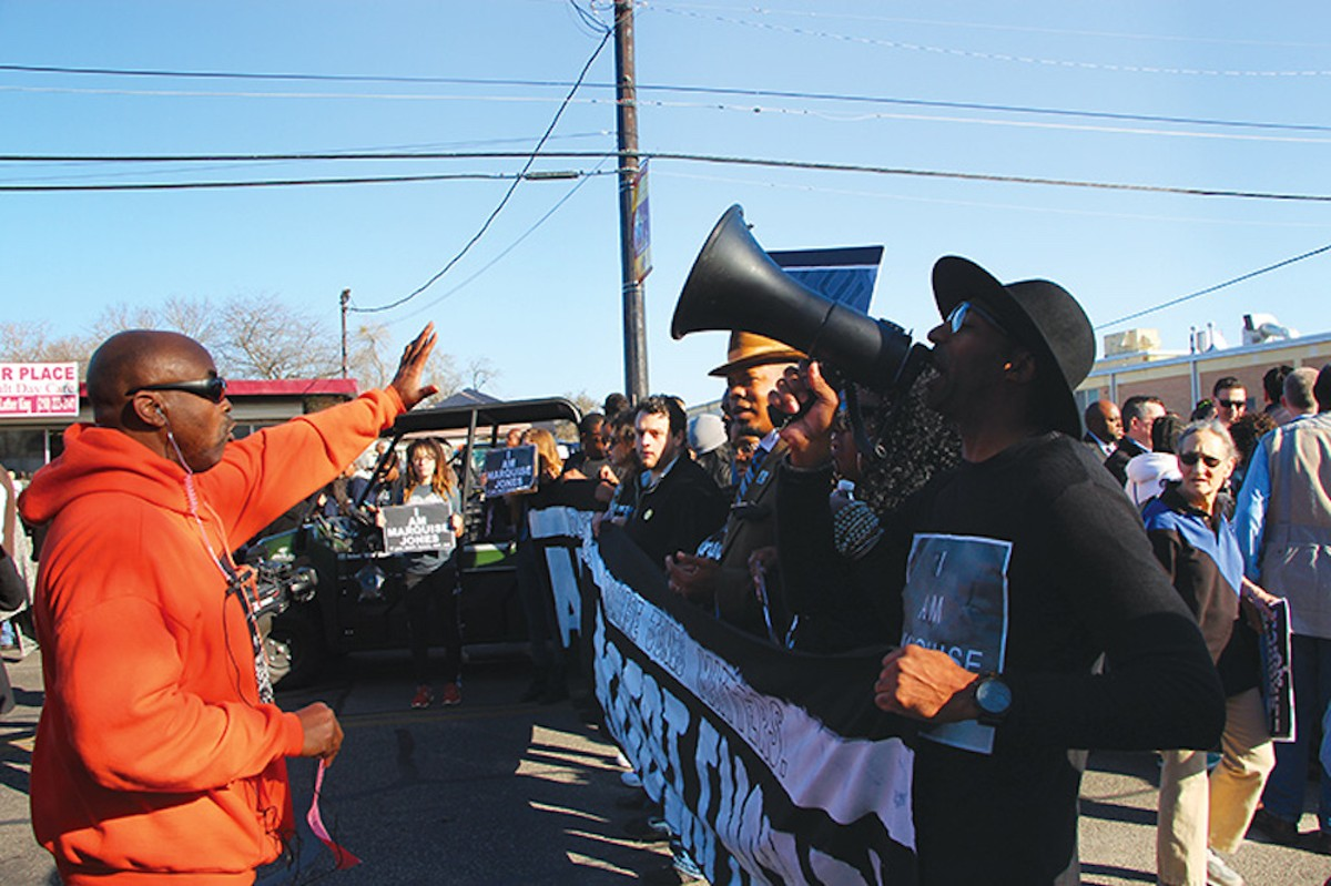 A man confronts activists moments before they took over the Martin Luther King Jr. Day march.