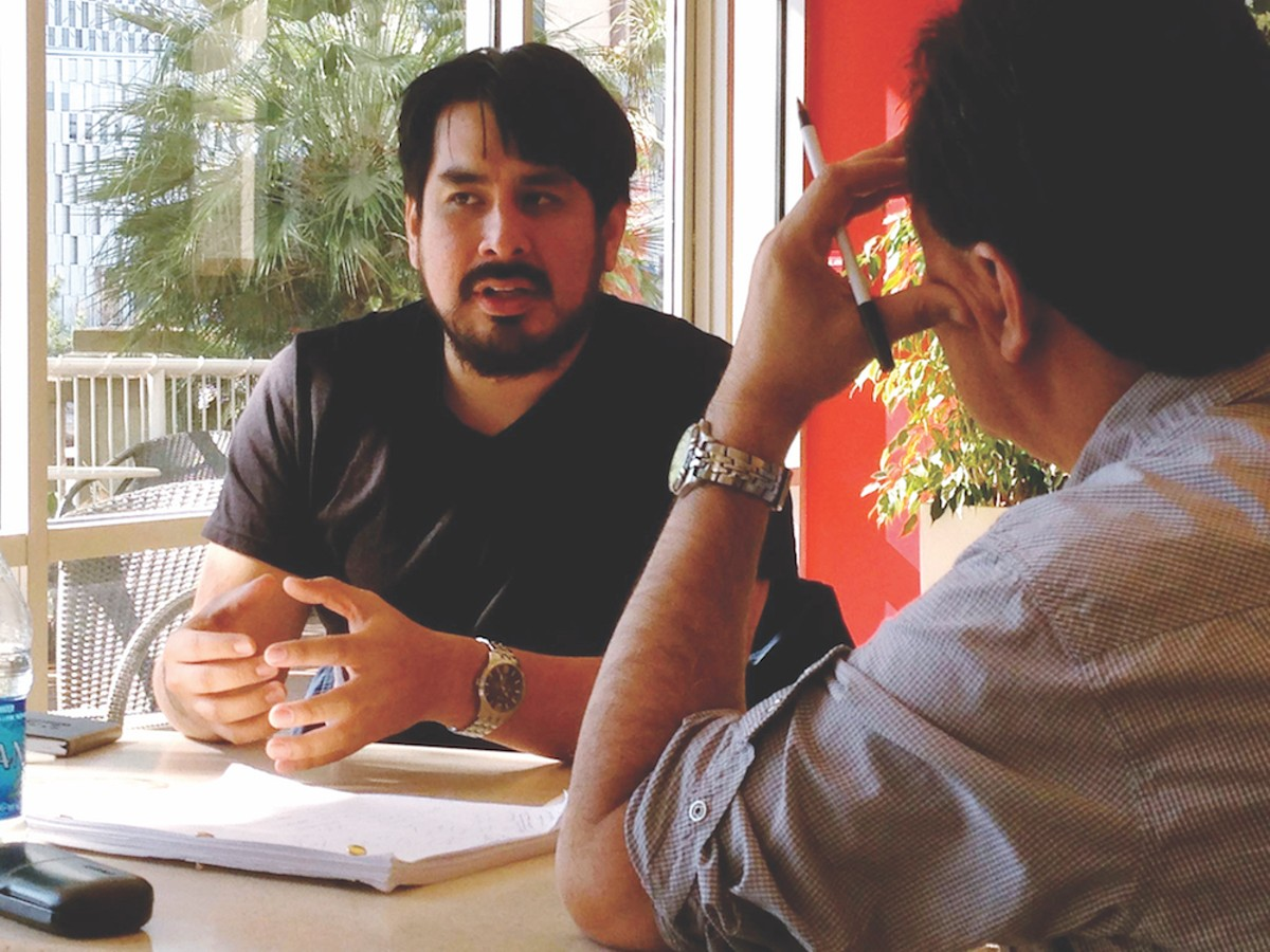 Latino Screenwriting Project fellow Julio O. Ramos in a meeting with advisor Carlos Avila