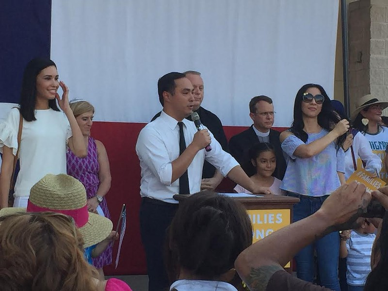 Joaquin Castro speaks at a recent West Side rally, surrounded by his family and local faith leaders. - SANFORD NOWLIN