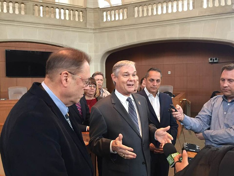 Councilman Clayton Perry, flanked by councilmen John Courage (left) and Greg Brockhouse (right), discusses the proposed homestead exemption at a news conference. - SANFORD NOWLIN