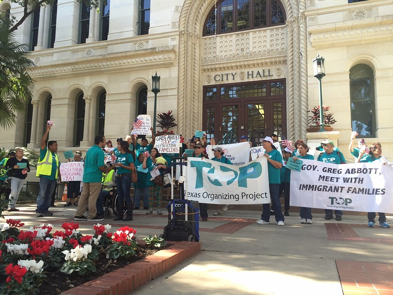 Members of the Texas Organizing Project gather outside of city hall during an immigration rally last year. - TEXAS ORGANIZING PROJECT