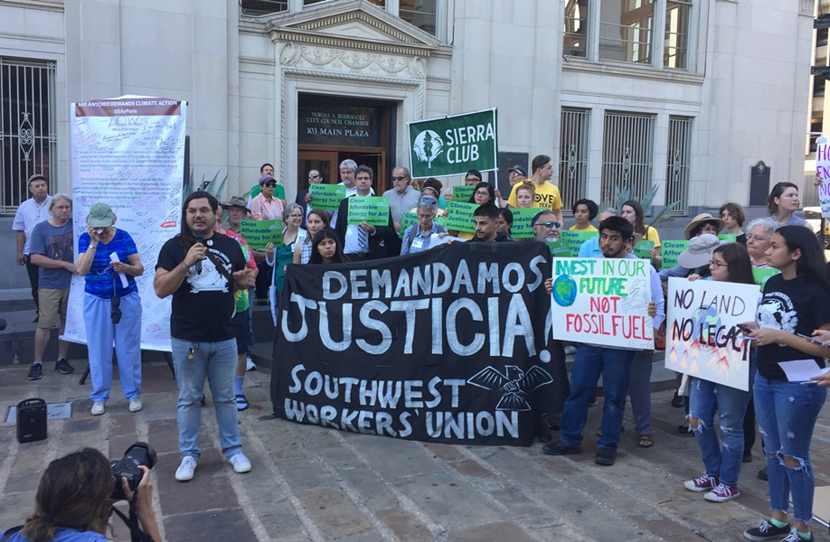 Climate activists rally in front of San Antonio's council chambers on Wednesday evening. - SANFORD NOWLIN