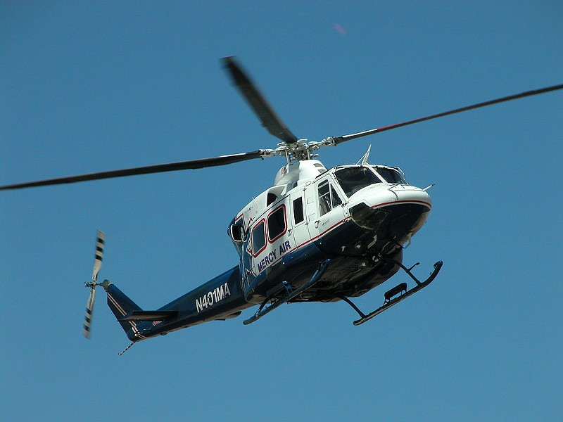 A helicopter operated by a subsidiary of Air Methods returns to its base. - ALAN RADECKI / WIKIPEDIA