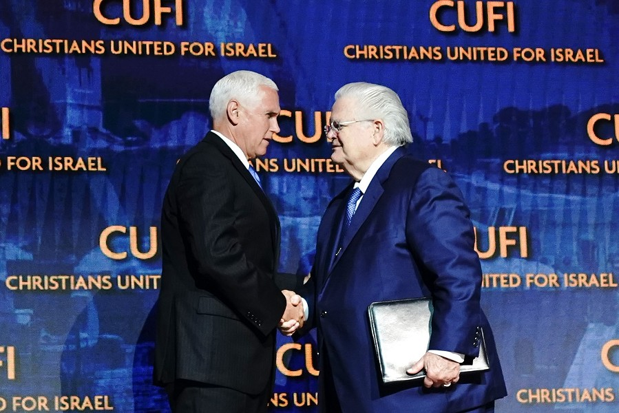 Pastor John Hagee (right) shakes the hand of Vice President Mike Pence at the CUFI summit in July. - CHRISTIANS UNITED FOR ISRAEL