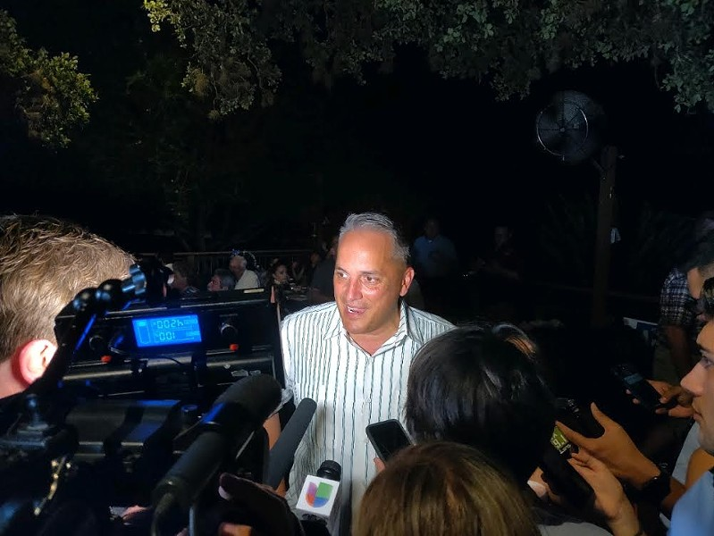 Greg Brockhouse speaks to the media at his watch party during the mayoral race. - JADE ESTEBAN ESTRADA