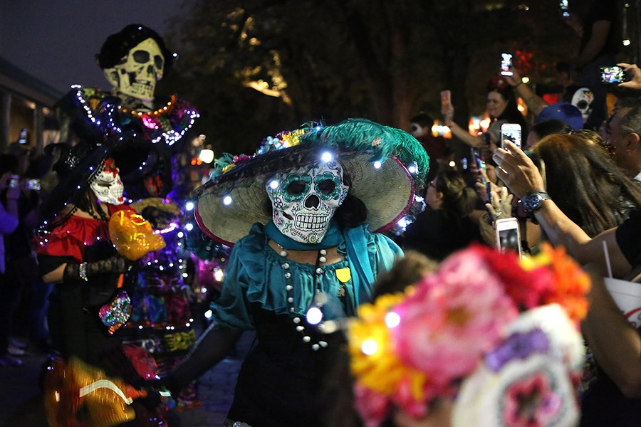 MPeople view a procession at Muertos Fest in La Villita. This year, the event is moving to Hemisfair. - BEN OLIVO