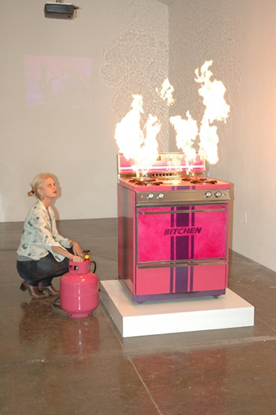 Pell in 2006 lighting up her Bitchen Stove, originally commissioned by Artpace San Antonio. - KIMBERLY AUBUCHON