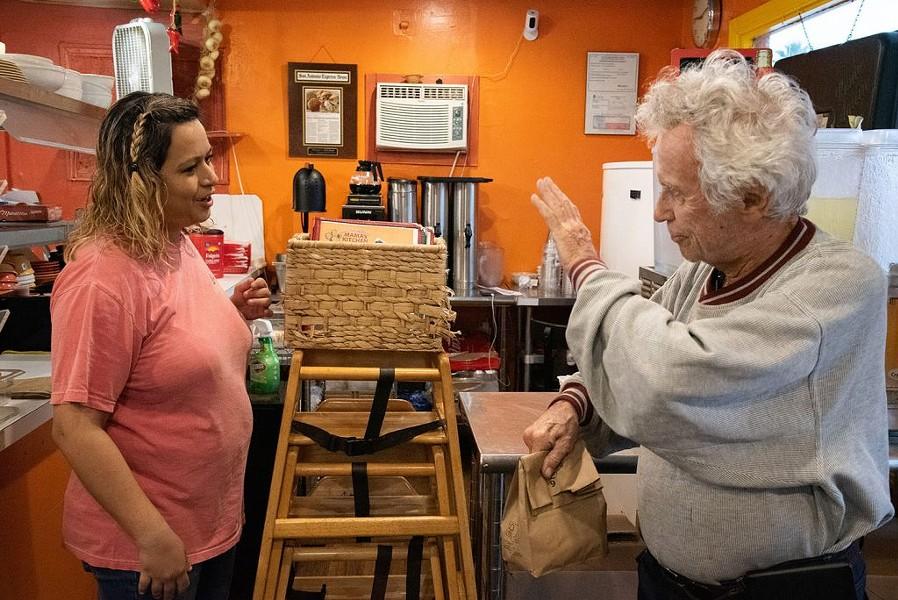 Tom Keene, 85, waves to co-owner Rocio Valdez at Mama's Kitchen, 504 W. Hildebrand Ave., on Thursday. - V. FINSTER   HERON CONTRIBUTOR