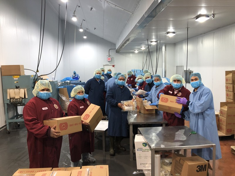GoodHeart Brand employees suit up to distribute meal kits to the SA Food Bank. - COURTESY GOODHEART BRAND SPECIALTY FOODS