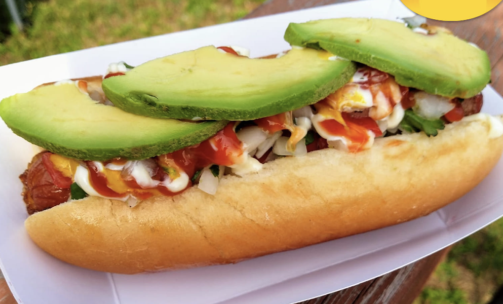 Doolittle's Machete Dog features a bacon-wrapped dog, loaded with pico de gallo, mayo, mustard and ketchup; topped with sliced avocado. - FACEBOOK / DOOLITTLE'S MOBILE KITCHEN & CATERING
