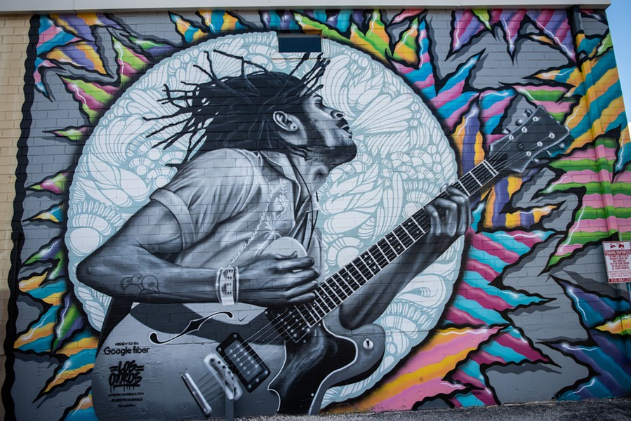 A portrait of Lonely Horse's Nick Long painted by Los Otros on the St. Mary's Strip. - JAIME MONZON