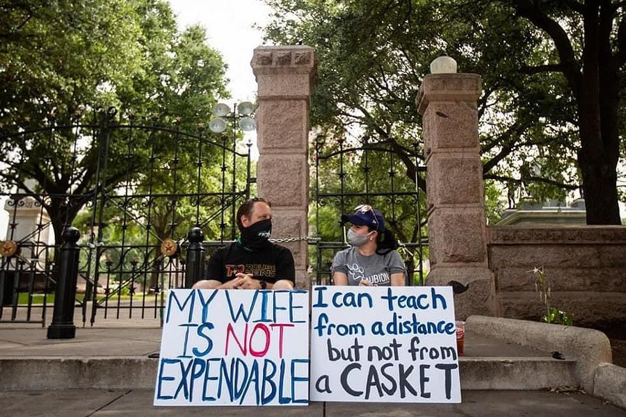 A Texas teacher and her husband attend a recent protest over the state's school reopening plan. - TWITTER / @BECKILAOSHI