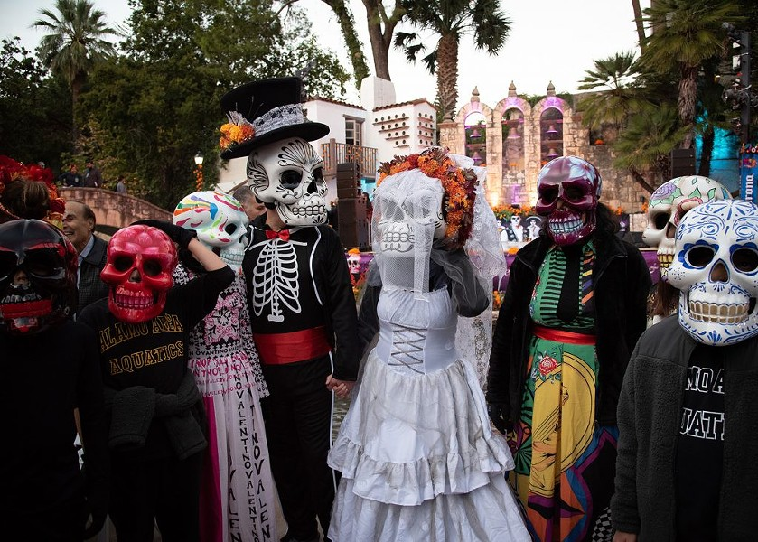 A calaveras bridal party gathers before the inaugural Catrinas on the River Parade on Nov. 1, 2019, at the Arneson River Theatre. - V. FINSTER / HERON CONTRIBUTOR