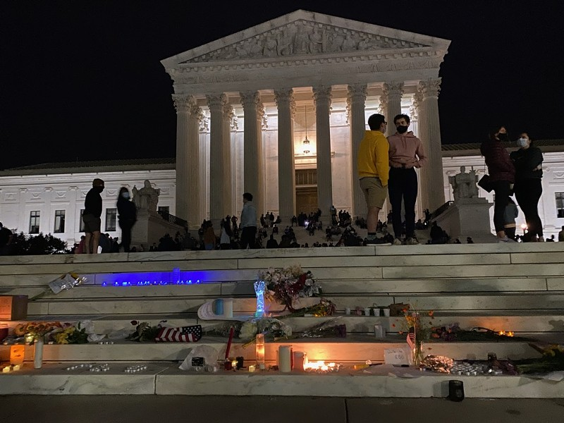 People leave memorials on the steps of the U.S. Supreme Court following the the death of Ruth Bader Ginsburg. - WIKIMEDIA COMMONS / STUART SEEGER