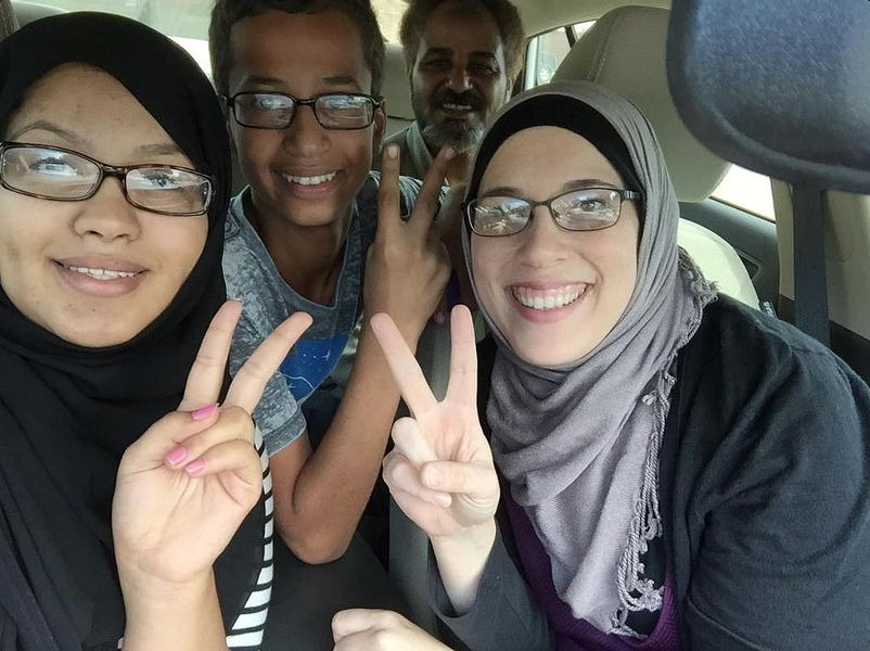 14-year-old Ahmed Mohamed (second from left) was arrested Monday after officials mistook his homemade clock for a bomb. - ALIA SALEM/TWITTER