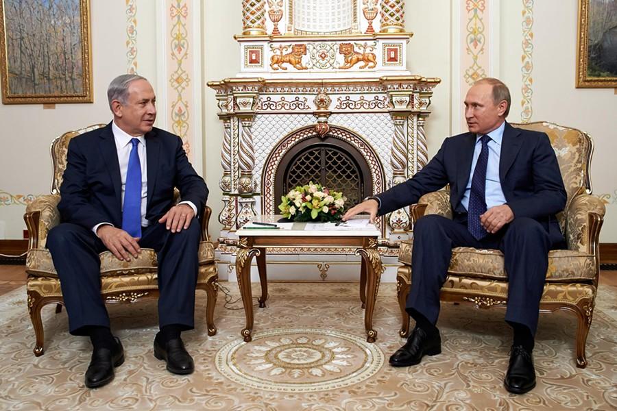 Israeli Prime Minister Benjamin Netanyahu sits with Russian President Vladimir Putin. - ISRAELI PRIME MINISTER BENJAMIN NETANYAHU | FACEBOOK