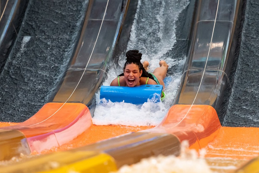 Singer songwriter Jordin Sparks rides the Cheetah Mat Racer maskless in a promo photo for the new indoor water park. - TWITTER / KALAHARIRESORTS