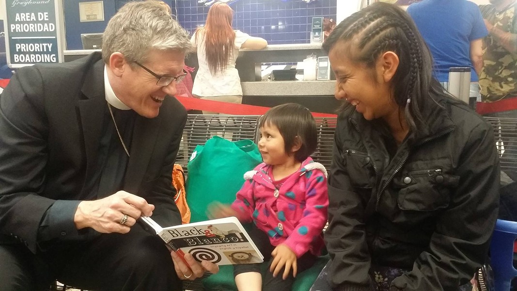 Immigration officials dropped this woman and her child off at a Greyhound station last March. RAICES visited the facility with this clergy member to hand care backpacks to mothers and children heading to all corners of the country after being released from detention facilities. - RAICES | FACEBOOK