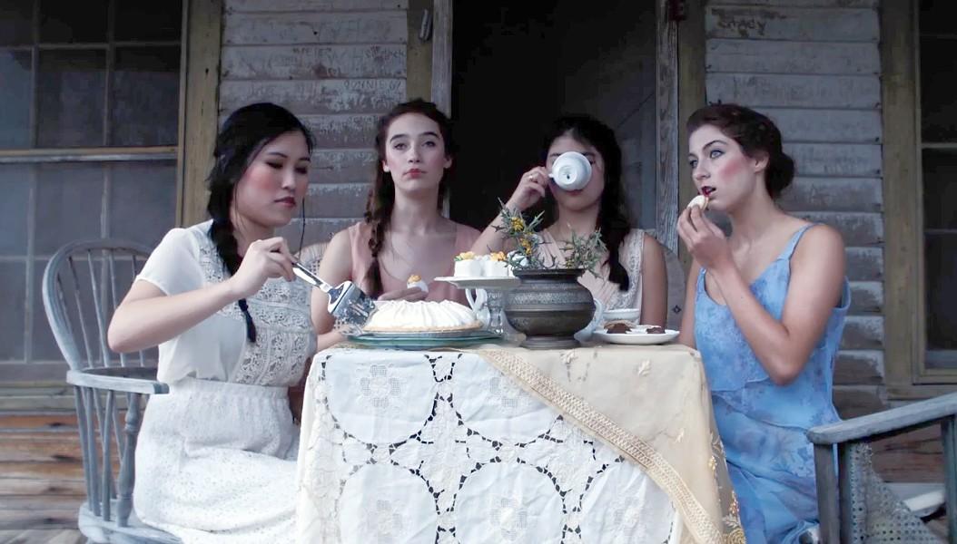 Actresses Ashley Drengler, Becca Brown, Rachel Miller and Jasmine Liu-Zarzuela sip tea and eat sweets in Lady of Paint Creek. - COURTESY