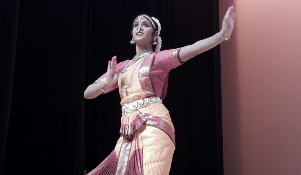 Dance student Gayathri Evani during a bharatanatyam performance in the documentary short Of Gods and Bells. - COURTESY