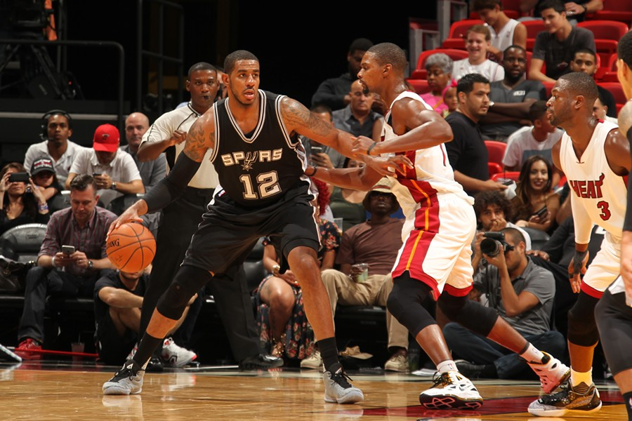 NBA All-Star LaMarcus Aldridge rumbles to the paint. - NBAE/GETTY IMAGES