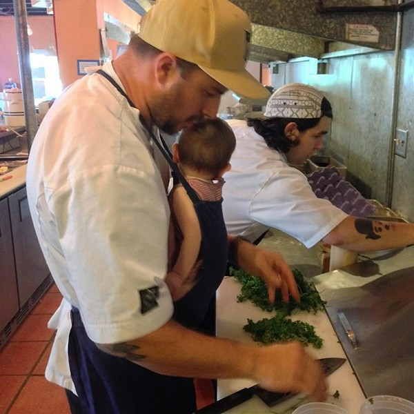 Sypesteyn cooking with his latest addition. - COURTESY