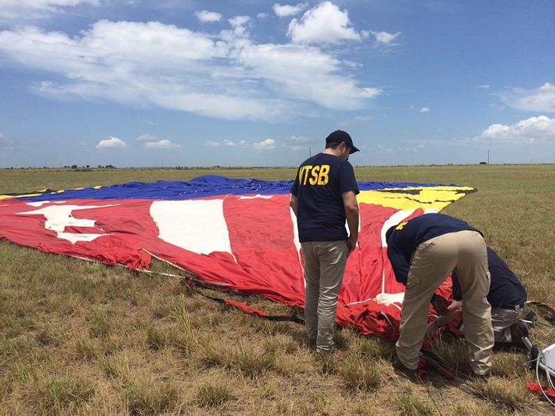 National Transportation Safety Board investigators at the site of a fatal hot-air balloon crash that killed 16 people in Lockhart, Texas. - NATIONAL TRANSPORTATION SAFETY BOARD