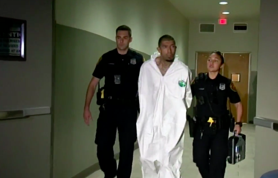 SAPD officers escort Capital Murder suspect Jason Prieto into a police car. - FOX SAN ANTONIO