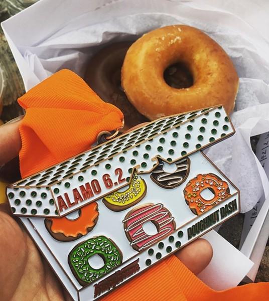 The finisher's medal for Doughnut Dash - ALLIE SEGURA